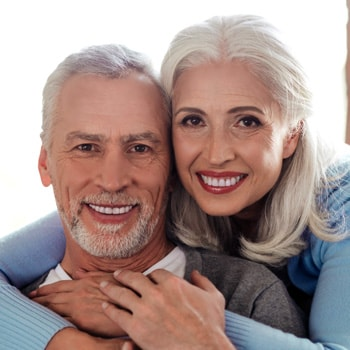 smile-older-couple-with-new-dental-implants