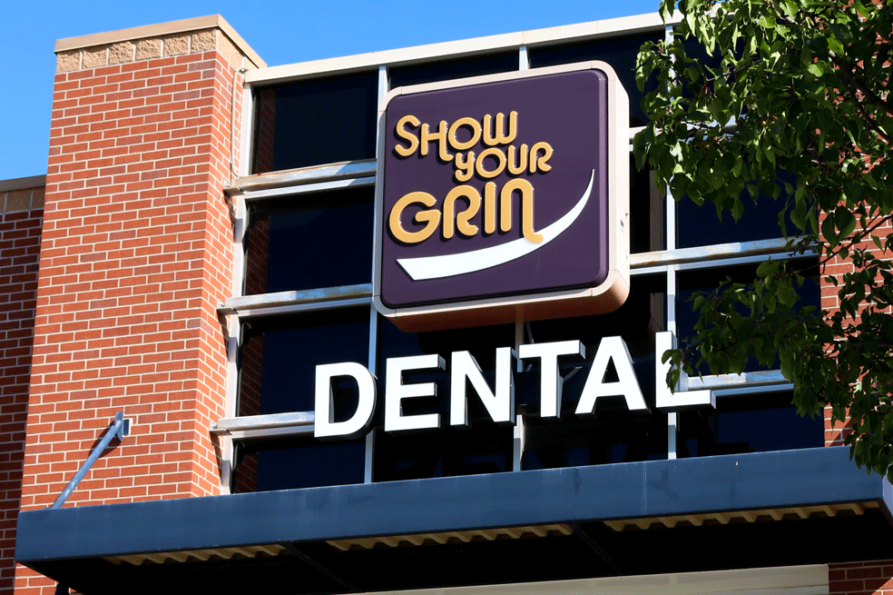 Large-glass-panes-create-the-front-facade-of-show-your-grin-dental's-office