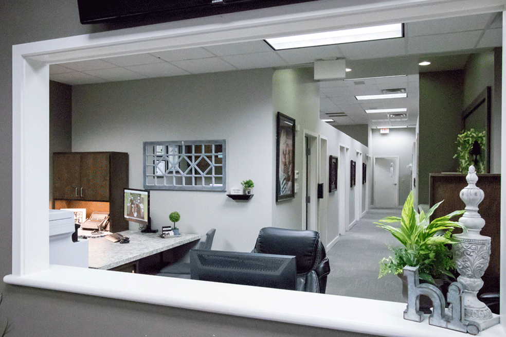 View-through-opening-at-reception-area-looking-back-into-dentist-rooms