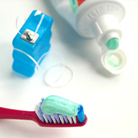 dental care basics of toothbrush, floss, and toothpaste