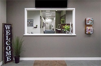 dentist-office-reception-window-in-show-your-grin-dental-in-Olathe
