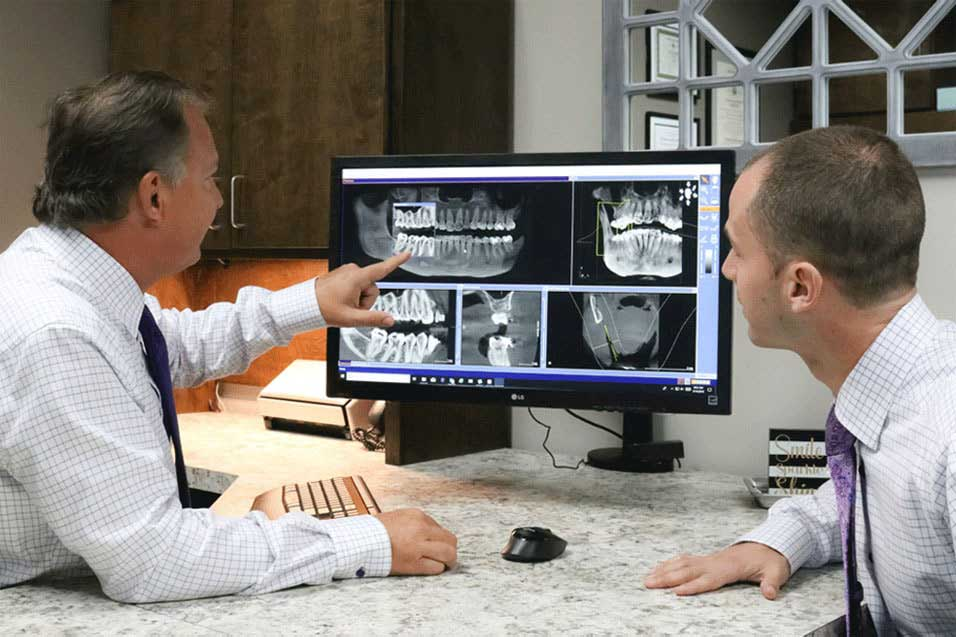 Dentists-reviewing-dental-xrays-min